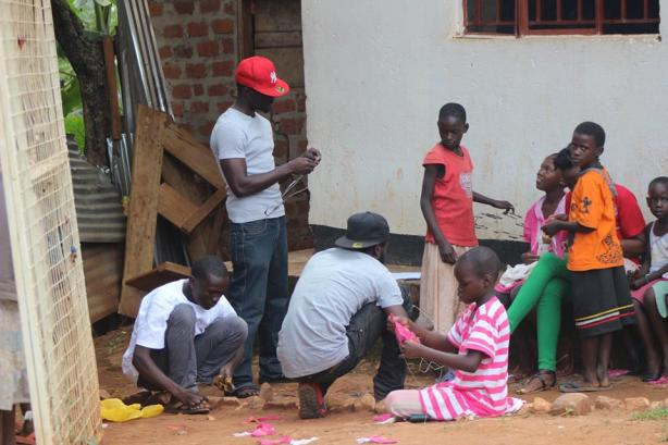 The Ghetto Film Project members with the kids making props for STIGMA short film